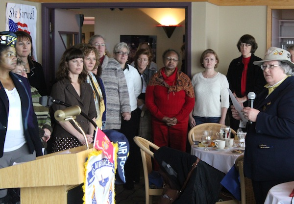 US Marine Corps veteran Julia Sheriden (far right) recognizes the service of other military veterans including Sheila Sebron (far left) at a Veterans Day brunch organized by Outreach and Resource Services for Women Veterans.