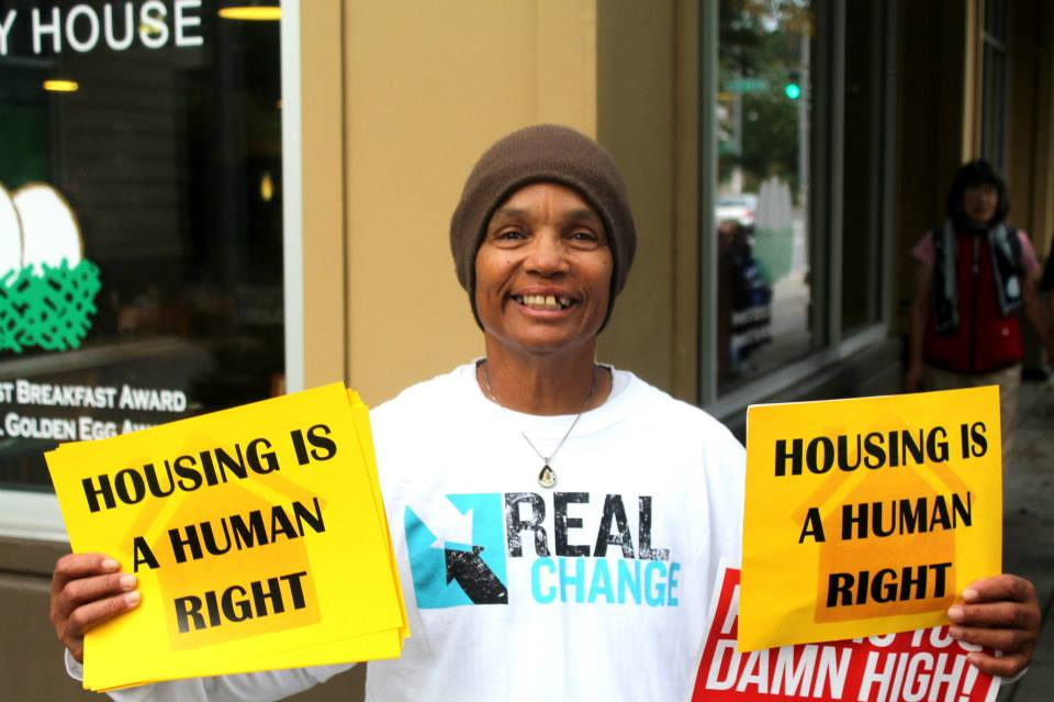 Sharon Jones protests a plan to turn low-income housing into for-profit housing. Image credit: Tenants Union of Washington.