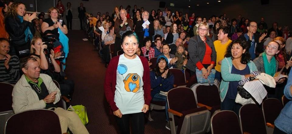 "Partnering with Seattle Art Museum for the screening of ""Inocente"" allowed us to reach a new audience of art lovers. Here, they give Inocente a standing ovation at the conclusion of the film. Photo by Steve Schimmelman."