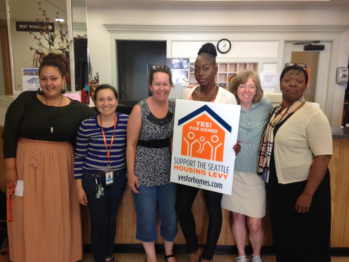 Staff at YWCA Seattle | King | Snohomish show their support for Prop. 1, the Seattle Housing Levy.